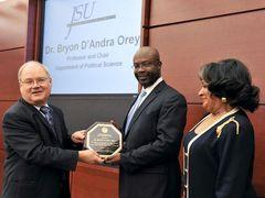 Dr. Orey receiving an award for his dedication to diversity advancement from Mr. Alan Perry (L), member of the Board of Trustees of State Institutions of Higher Learning and Dr. Carolyn Meyers (R), President of Jackson State University