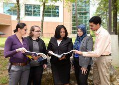 Dr. Cynthia Taylor (center), interacting with her students