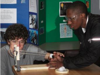 Aeronautics engineering students test launch and range angles on their ballistics apparatus.