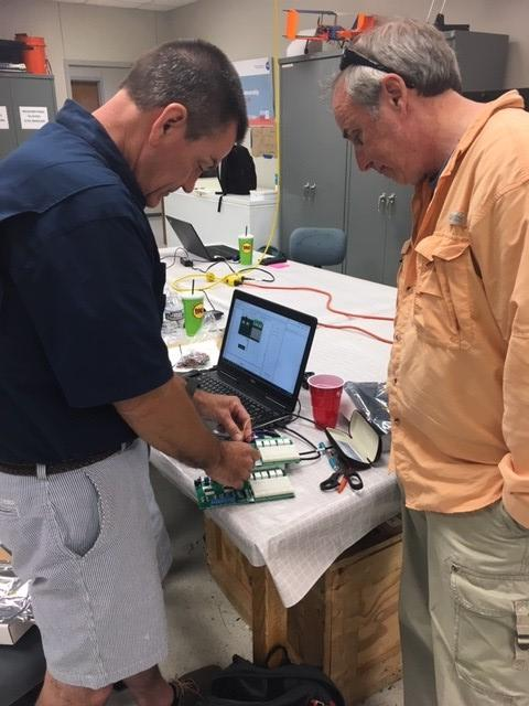 Teacher Robbie Albertson and STTI Lead Learner Bill Vivian use LabVIEW to monitor an experiment.