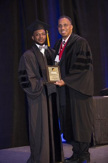 Dr. Archie Taylor poses with Dr. Ansley Abraham