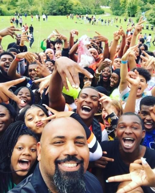 Photo of principal and students at Back-to-School Picnic