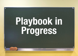 playbook in progress text on a chalkboard background
