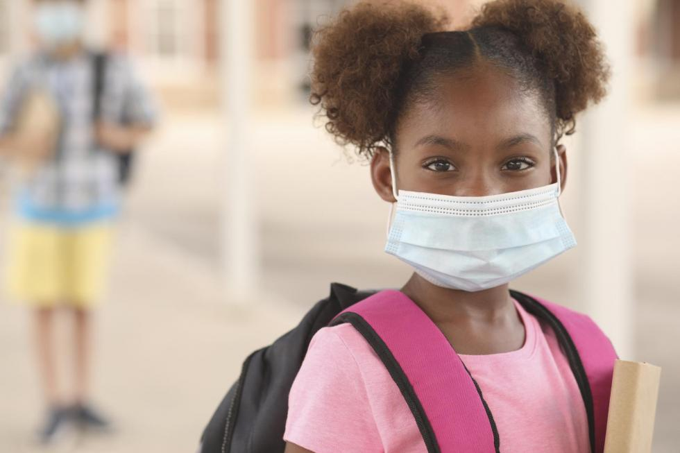 elementary aged girl wearing a protective mask