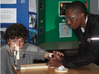 Aeronautics engineering students test launch and range angles on their ballistics apparatus.